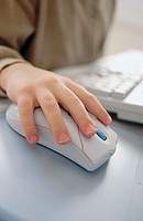 Close up of hand on computer mouse