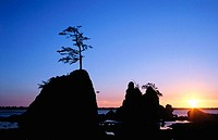 Sunset over a rocky beach at Tillamook Bay. Oregon. USA