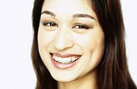 image of young woman with braces, smiling