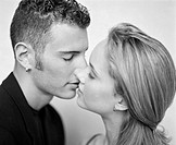image of young couple kissing