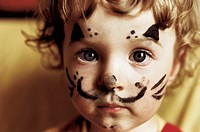 Portrait, Young Girl with Face Painted Like Cat´