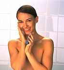 Woman Washing Face with Sponge