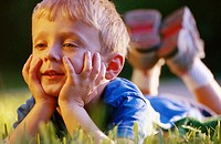 Boy (4yrs) lying in the grass