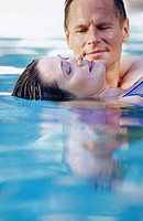 Middle aged couple in pool