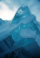 CREDIT: DOUG ALLAN/SCIENCE PHOTO LIBRARY Iceberg tip.  The opaque snow layers contrast with the sunlight filtering through the translucent ice of the ...
