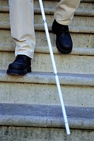 CREDIT: CRISTINA PEDRAZZINI/SCIENCE PHOTO LIBRARY Blind man descending stairs,  with the  aid  of  a white cane (stick).