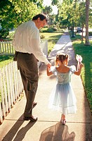 Father & daughter. Young girl in princess costume
