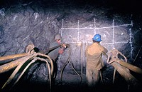 Miners drilling new section of underground gold mine.  Stikine Valley, BC, Canada