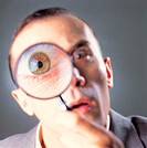 Photo of a man looking through a magnifying glass, man, magnifying glass eye.