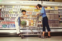 Mother with her child grocery shopping