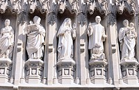 Detail of sculptures on the west facade of Westminster Abbey, built in Gothic style. London. England