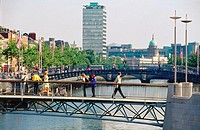 Millennium Bridge over the Liffey River, Ha'penny Bridge behind. Dublin. Ireland