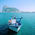 Fishing boat in front of Rock of Gibraltar. La Linea de la Concepcion. Spain