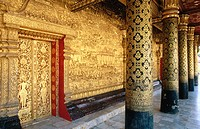 Columns and door on verandah of Wat Mai temple. Luang Prabang. Laos
