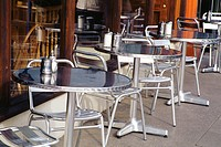 Tables on footpath outside coffee shop