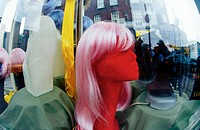 Dummy with wig in shop window
