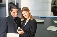 Two businesspeople working with personal organizer