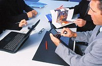 Executives in conference, businessman working with personal organizer