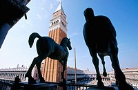 Bronze horses (copy) and Campanile. St. Mark's Basilica. Venice. Italy