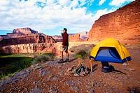 A man camping near Dead Horse Point, Utah, USA, above the Colorado River