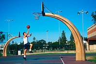Man plays basketball on a neighborhood court