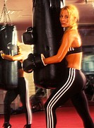 Woman boxer in a boxing gym