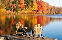 Adirondack chairs in a dock in autumn. Starlight. Pennsylvania. USA