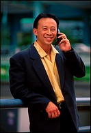 Asian male executive with handphone