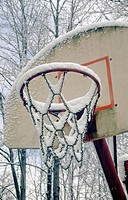 Snow on outdoor basketball hoop, Indiana, USA