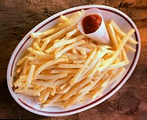 French Fries with Ketchup on an Oval Plate