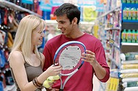 Couple at the sports section of a shopping center