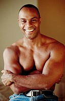 Smiling muscular black man without shirt