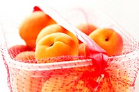 Apricots in plastic basket