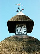 Clock and thatched roof