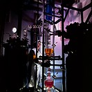 ´Chemist.  Industrial chemist monitoring a reaction in  a factory.   He is adjusting part of the large reaction column.  He is wearing glasses and glo...