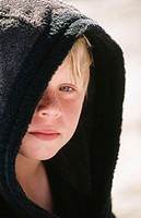 Boy in black bathrobe