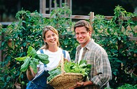 couple in vegetable garden