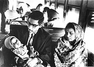 Husband and wife with their child in a railway compartment New Delhi-Agra train. India