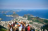Tourists in Mount Corcovado contemplating Rio de Janeiro from above. Brazil