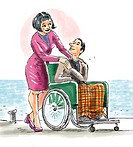 Couple on beach, man in wheelchair