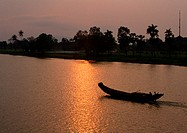 Vietnam, fishing canoe, at sunset