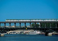France, Paris, subway train on bridge over river