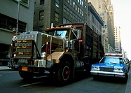 USA, truck next to police car on city street