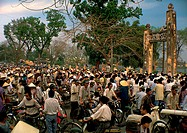 Crowded scene in Vietnam, people on bicycles