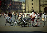 Mexico, people on bicycles in square