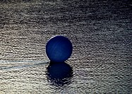 Ball on wet sand