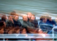 People on tour in motion, blurred