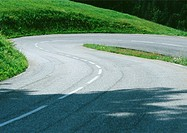 Hairpin turn through grassy landscape