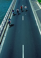 Bicyclists on bridge, high angle view