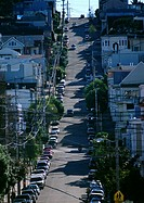 California, San Francisco, steep city street with cars lining road
